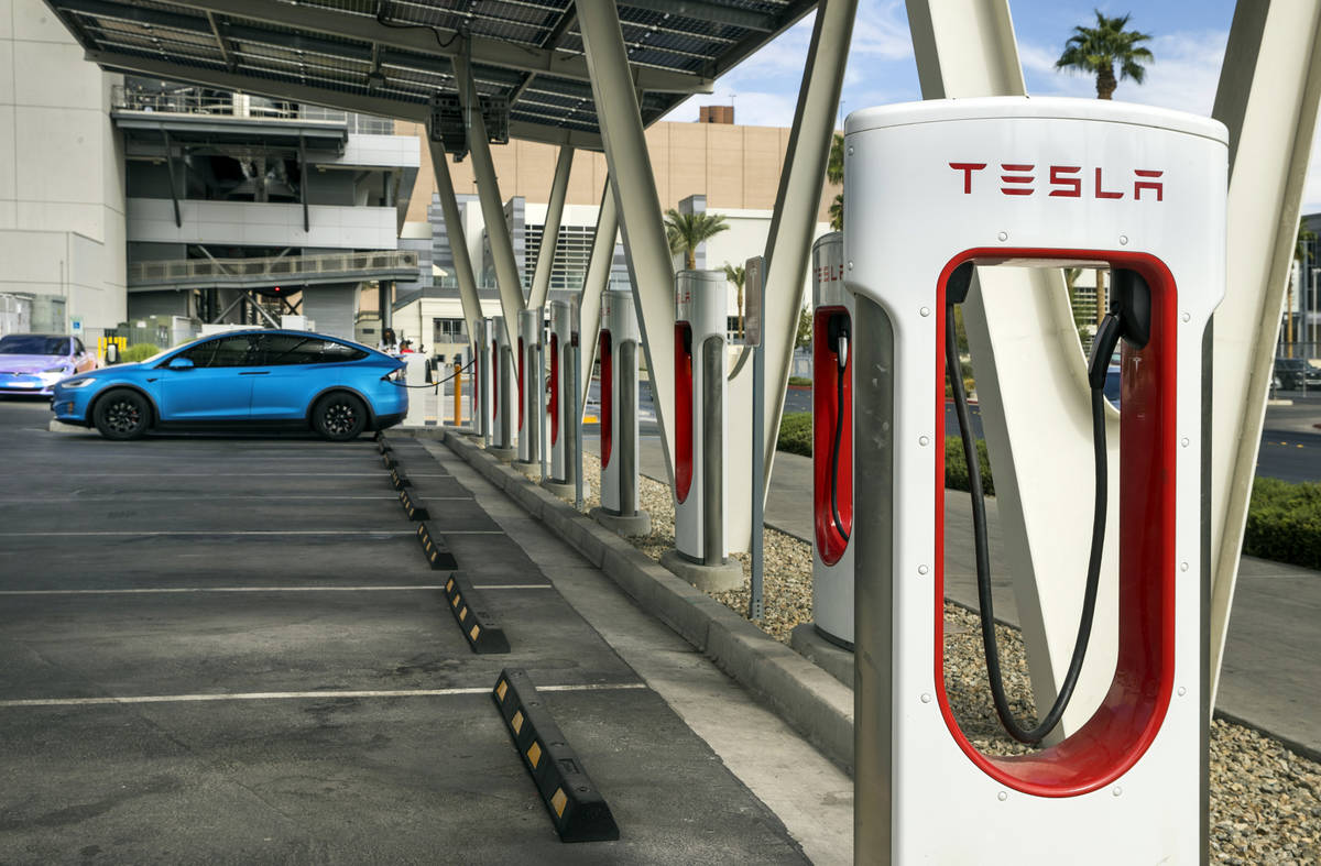 A car is plugged in at the Tesla Supercharger station near The Linq and High Roller on Friday, ...