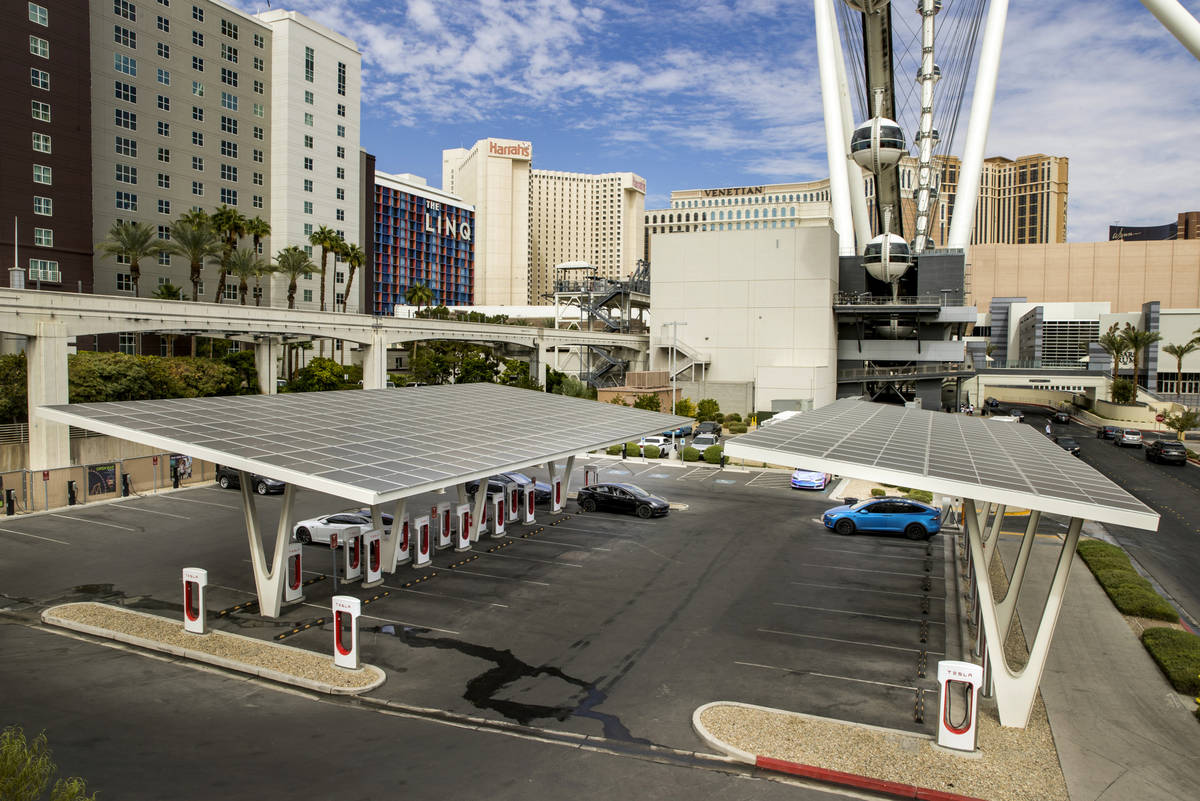 Cars are plugged in at the Tesla Supercharger station near The Linq and High Roller on Friday, ...