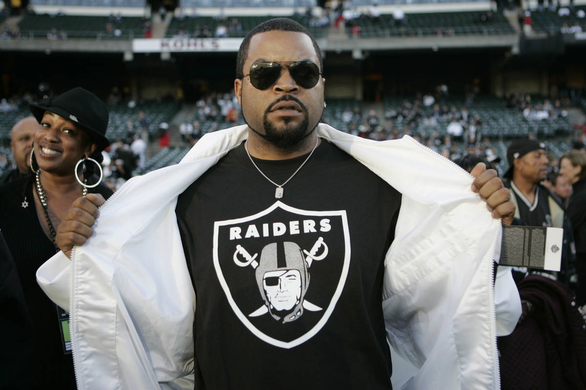 Rapper Ice Cube flashes his Raiders t-shirt at the NFL football game between the Oakland Raider ...