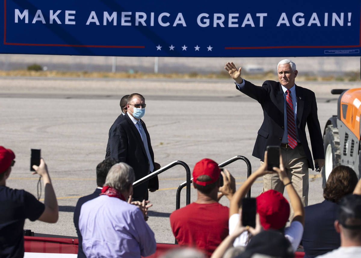Vice President Mike Pence waves to the crowd as he takes the stage during Make America Great Ag ...