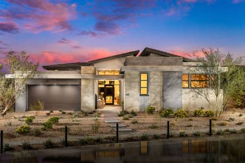 The Sandstone floor plan at Mesa Ridge by Toll Brothers in the Mesa village features a built-in ...
