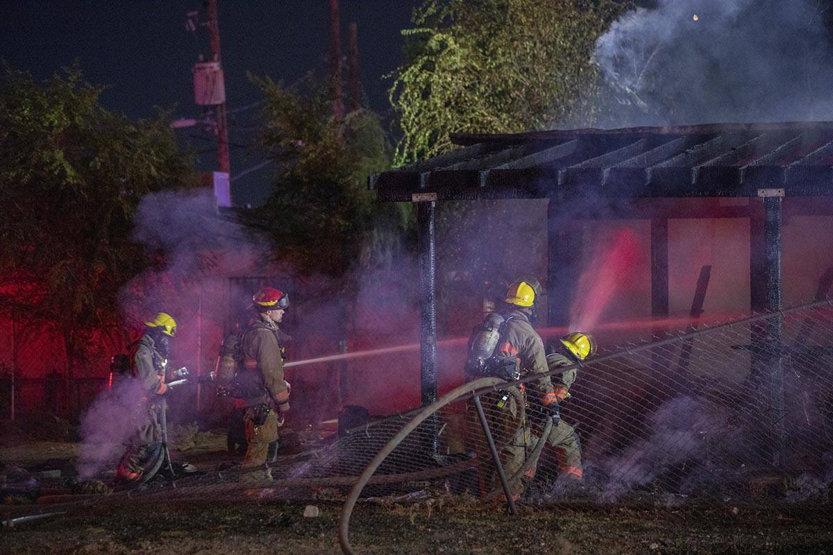 Las Vegas Fire Department firefighters put out a fire that burned a small home at West Cincinna ...