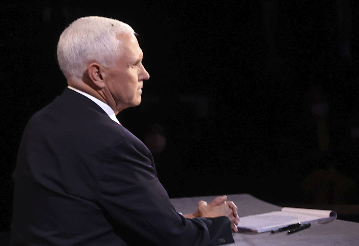 A fly lands on the head of Vice President Mike Pence during the vice presidential debate Wednes ...