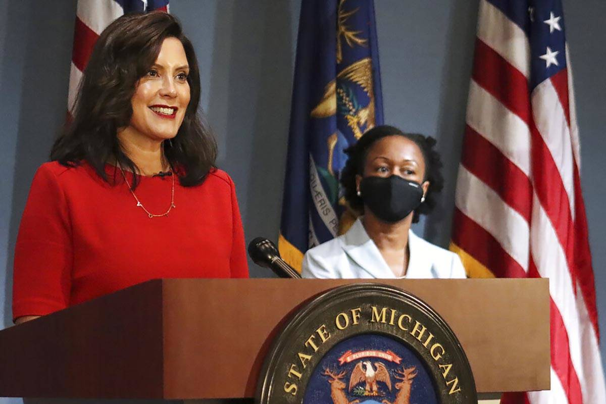 In a photo Sept. 16, 2020, file photo, provided by the Michigan Office of the Governor, Gov. Gr ...