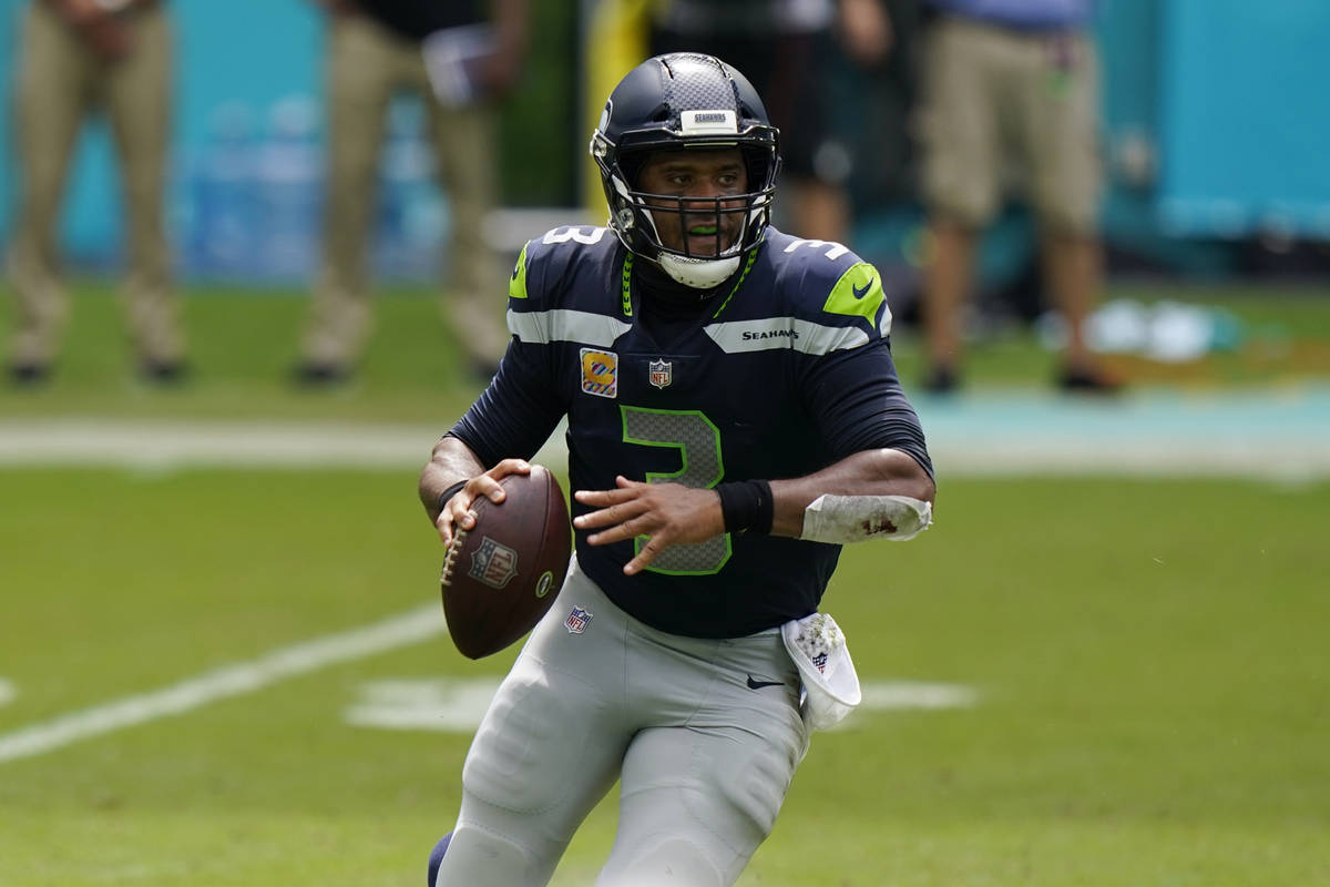 Seattle Seahawks quarterback Russell Wilson (3) looks to pass the ball during the first half of ...