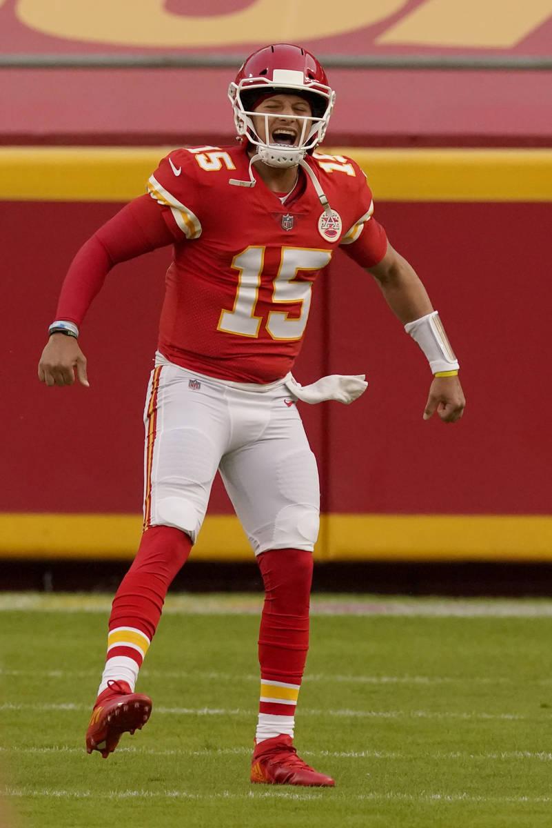 Kansas City Chiefs quarterback Patrick Mahomes celebrates as he runs onto the field during the ...