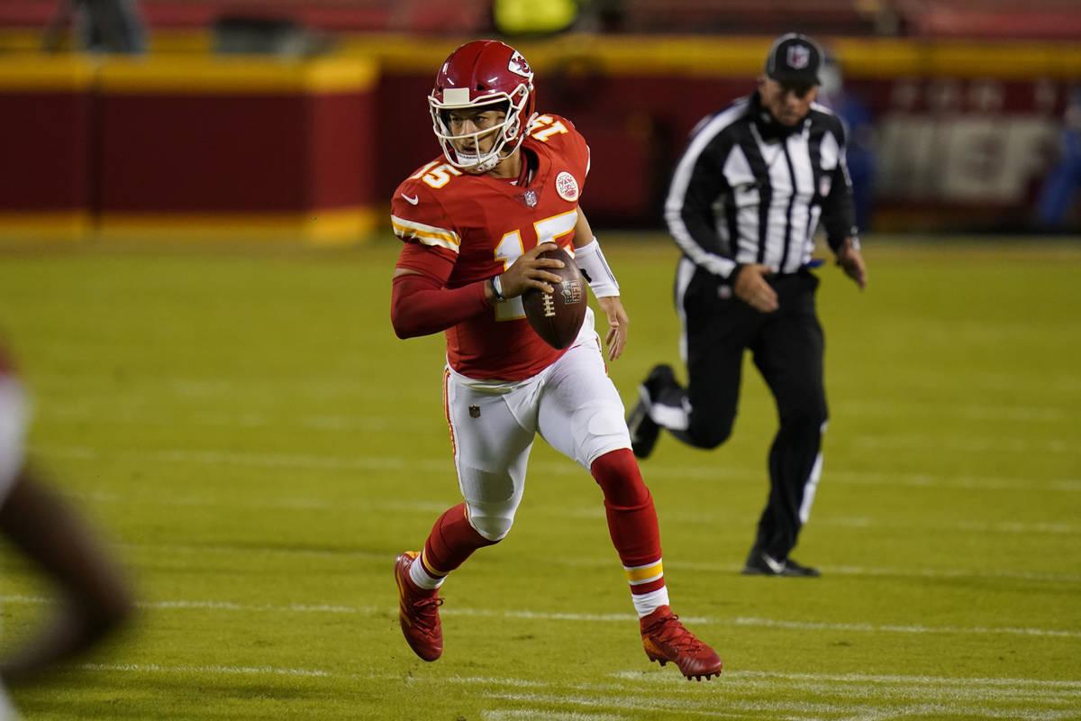 Kansas City Chiefs quarterback Patrick Mahomes (15) runs against the New England Patriots durin ...