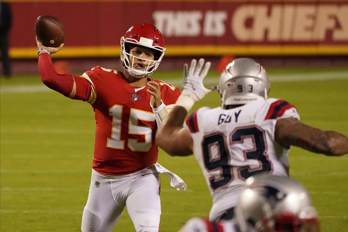 Kansas City Chiefs quarterback Patrick Mahomes (15) throws as New England Patriots defensive ta ...