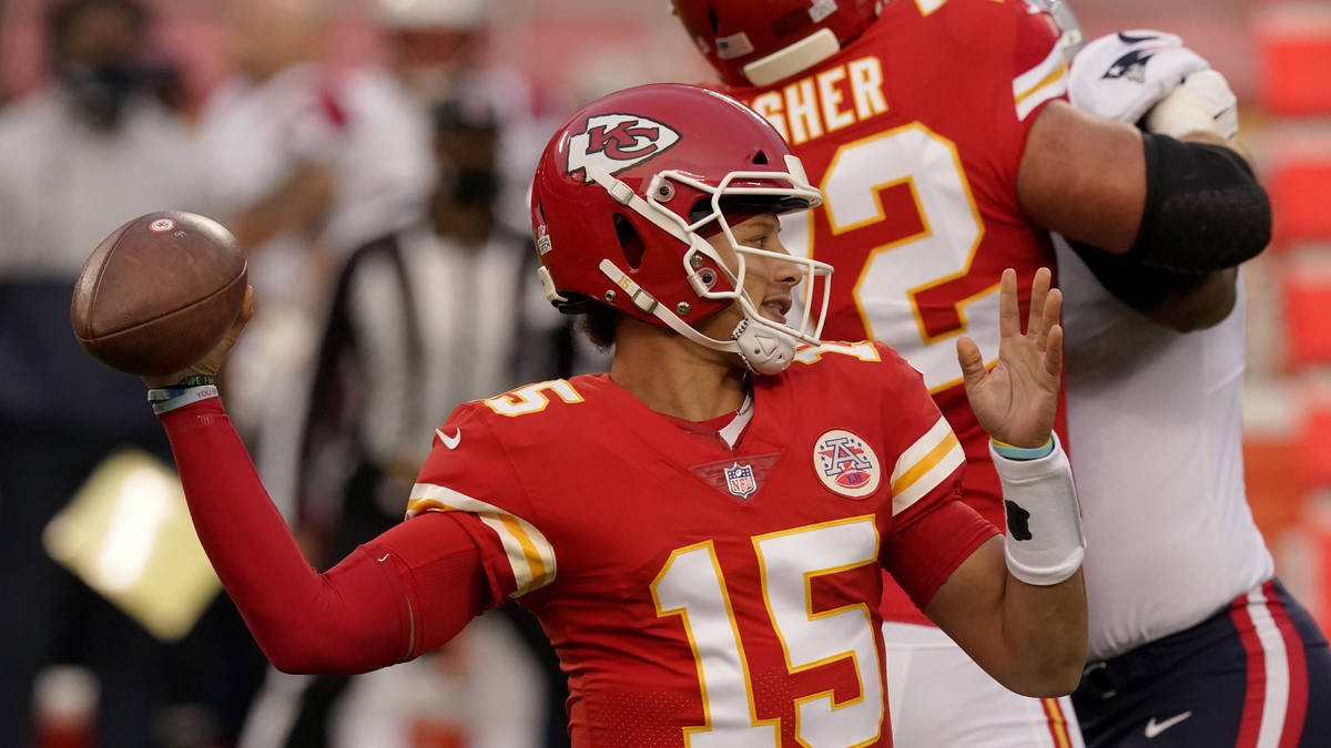 Kansas City Chiefs quarterback Patrick Mahomes (15) throws during the first half of an NFL foot ...