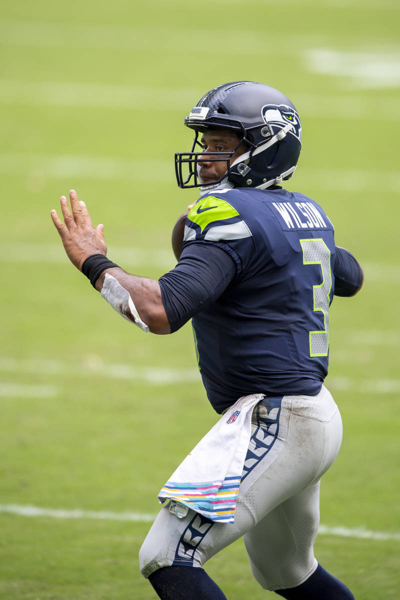 Seattle Seahawks quarterback Russell Wilson (3) throws the ball against the Miami Dolphins duri ...