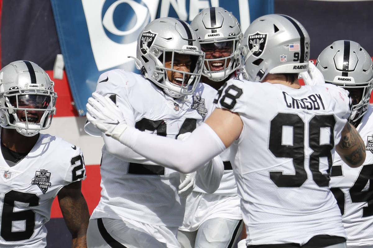 Las Vegas Raiders strong safety Johnathan Abram celebrates after he intercepted a pass and retu ...