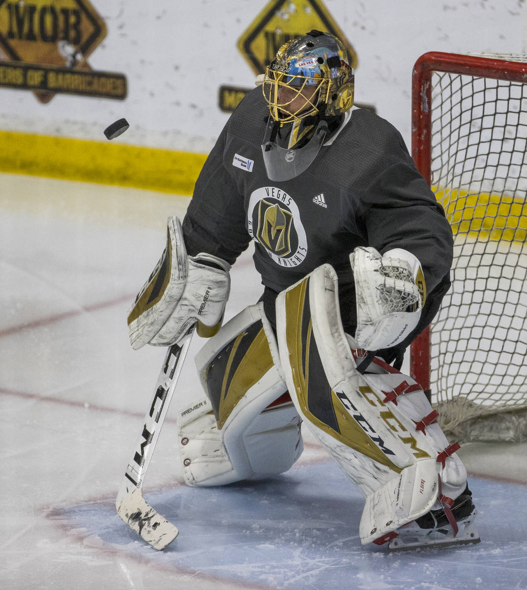 Vegas Golden Knights goaltender Marc-Andre Fleury (29) deflects a shot during practice at City ...