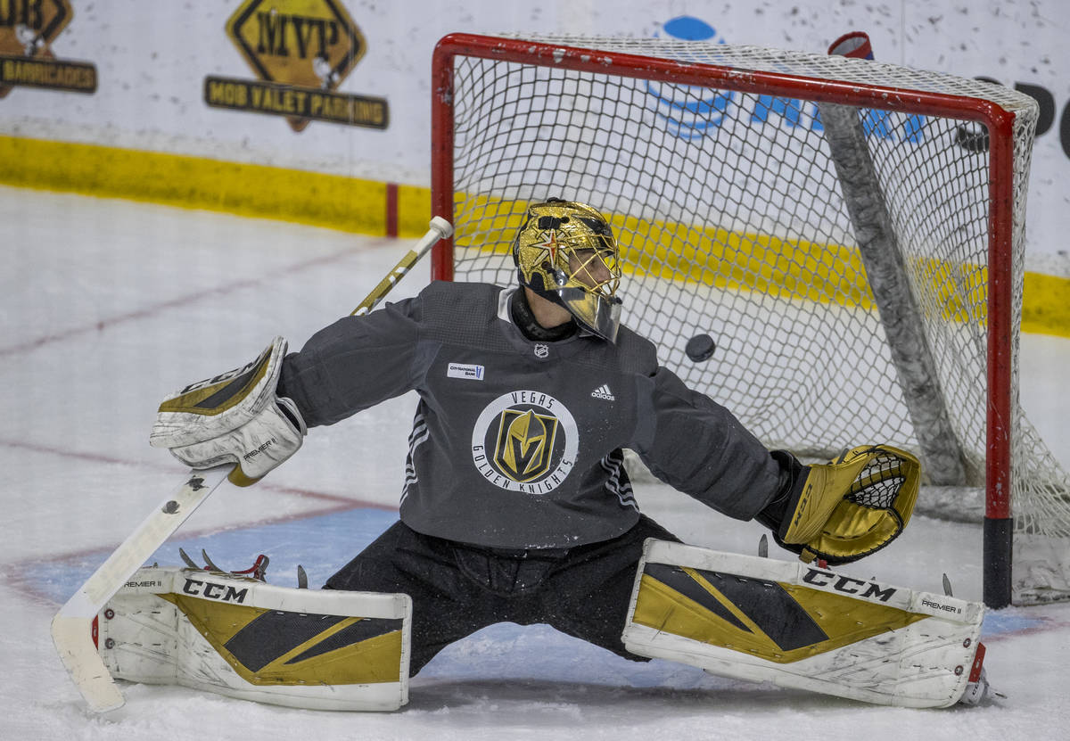 Vegas Golden Knights goaltender Marc-Andre Fleury (29) reaches back to attempt a puck stop duri ...