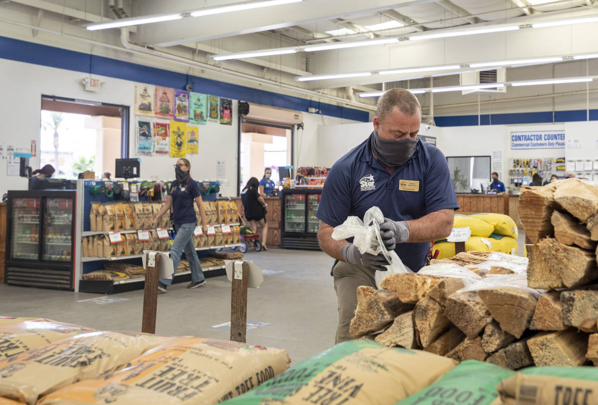 General manager Marco Marrocco unwraps firewood at Star Nursery on W Tropicana Ave.,Thursday, O ...