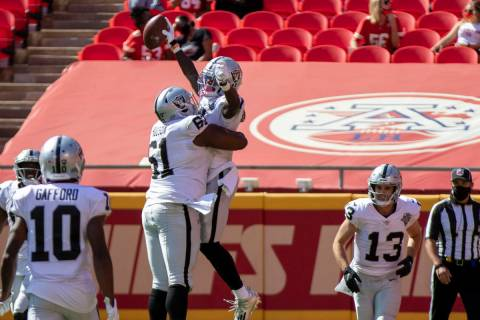 Las Vegas Raiders wide receiver Henry Ruggs III (11) celebrates his touchdown score with center ...