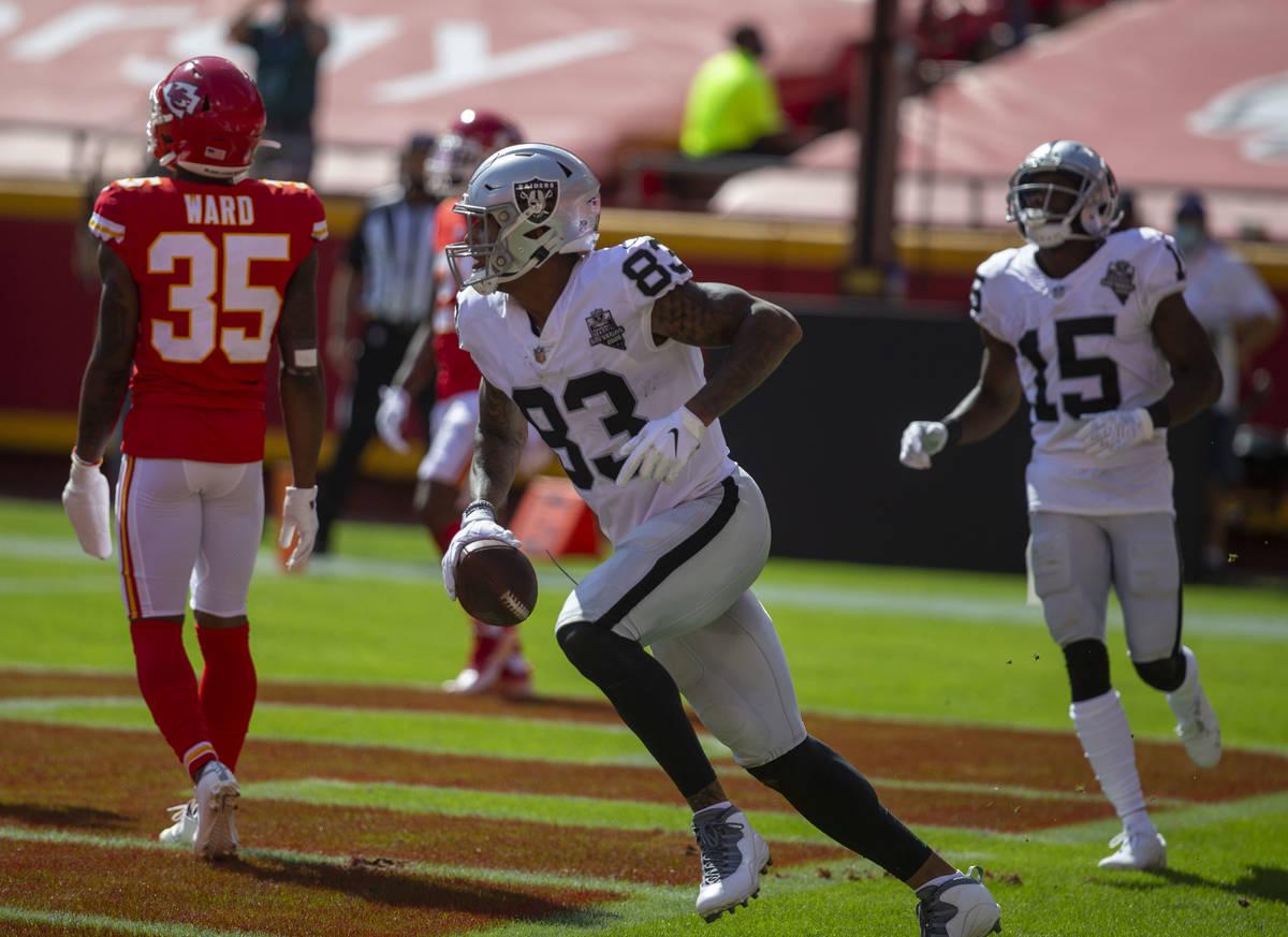 Las Vegas Raiders tight end Darren Waller (83) scores a touchdown as defender Kansas City Chief ...