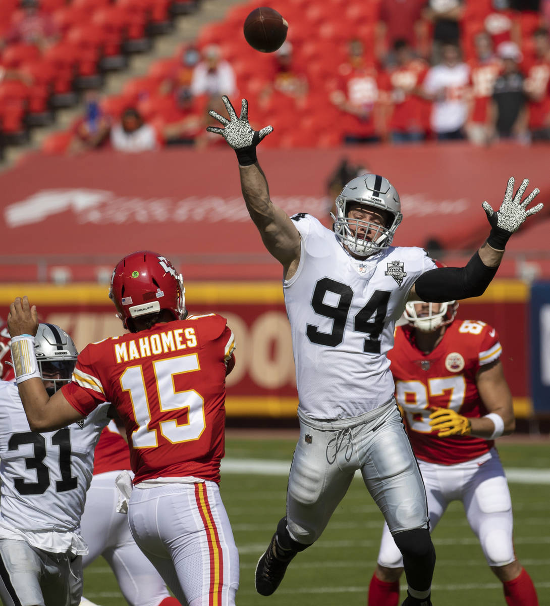 Las Vegas Raiders defensive end Carl Nassib (94) tries to bat down a pass from Kansas City Chie ...