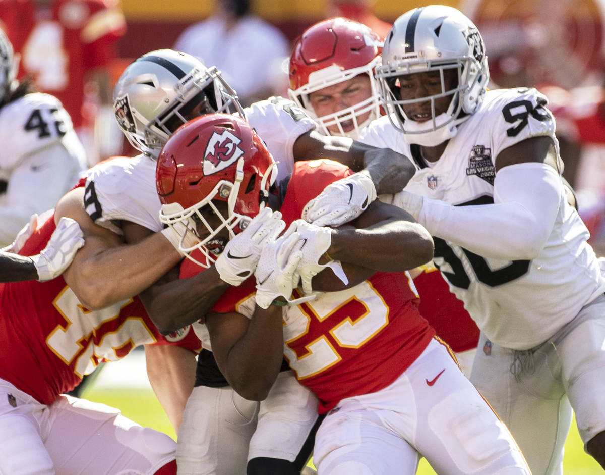 Kansas City Chiefs running back Clyde Edwards-Helaire (25) is stopped at the line of scrimmage ...
