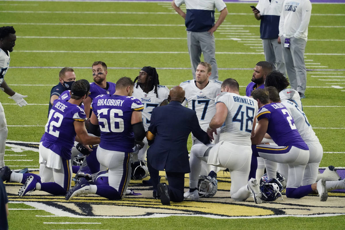 FILE - In this Sept. 27, 2020, file photo, Tennessee Titans and the Minnesota Vikings players ...