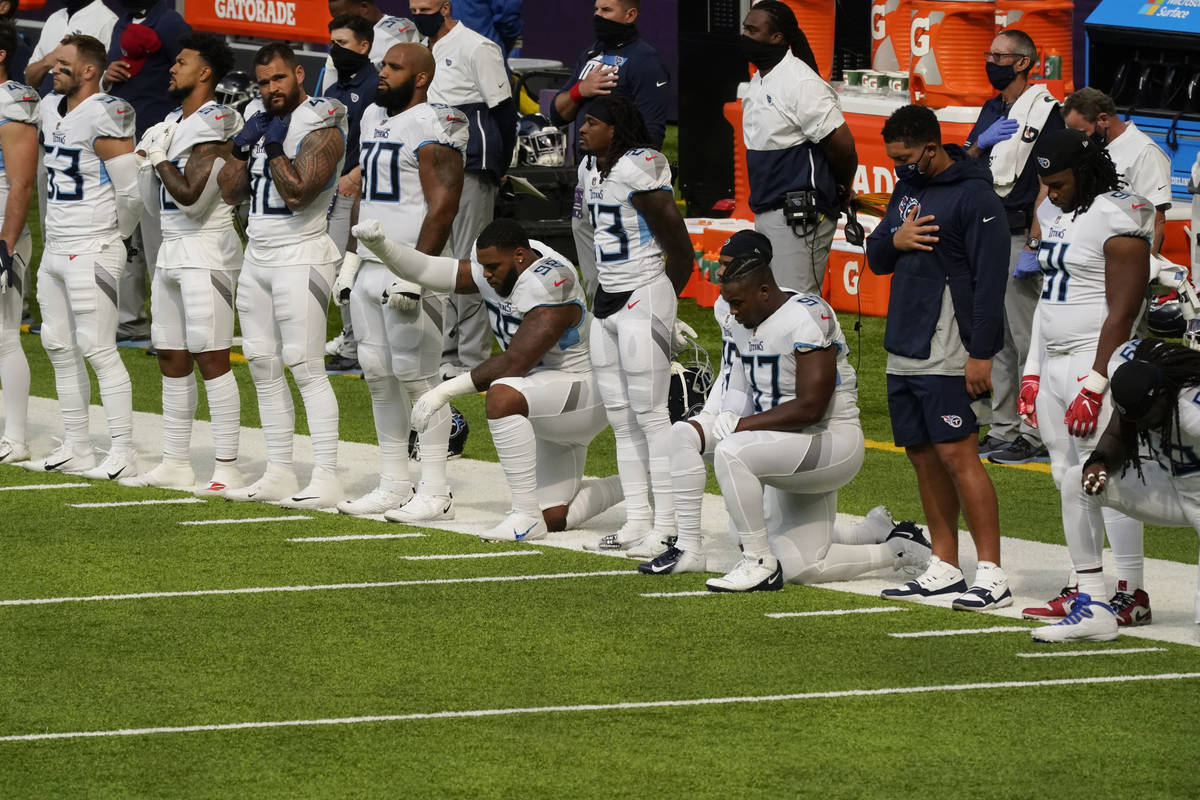 FILE - In this Sept. 27, 2020, file photo, members of the Tennessee Titans take part in the nat ...