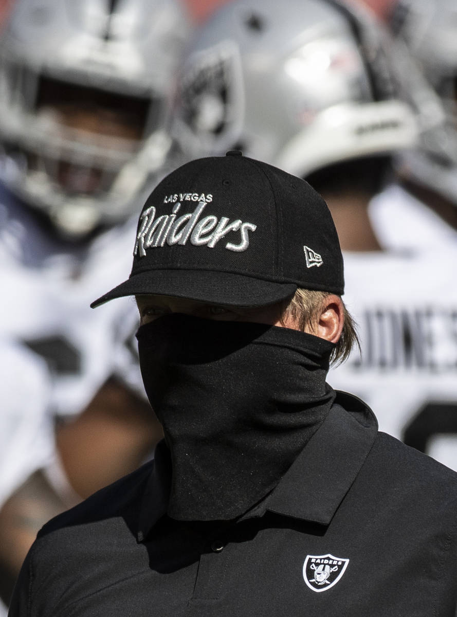 Las Vegas Raiders head coach John Gruden leads warm ups before the start of an NFL football gam ...