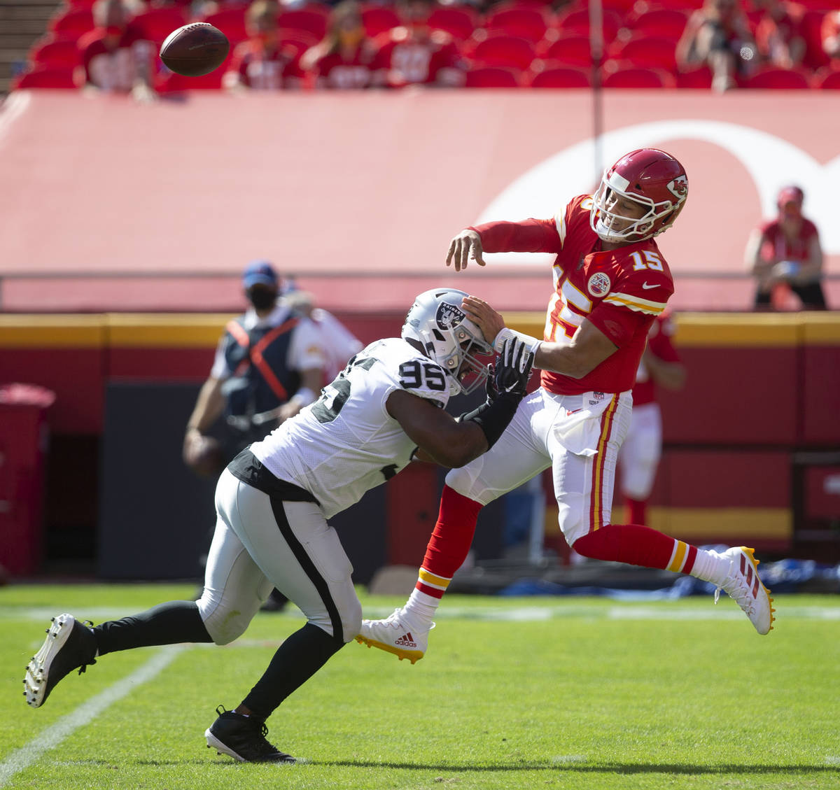 Las Vegas Raiders defensive end Clelin Ferrell (96) pressures Kansas City Chiefs quarterback Pa ...