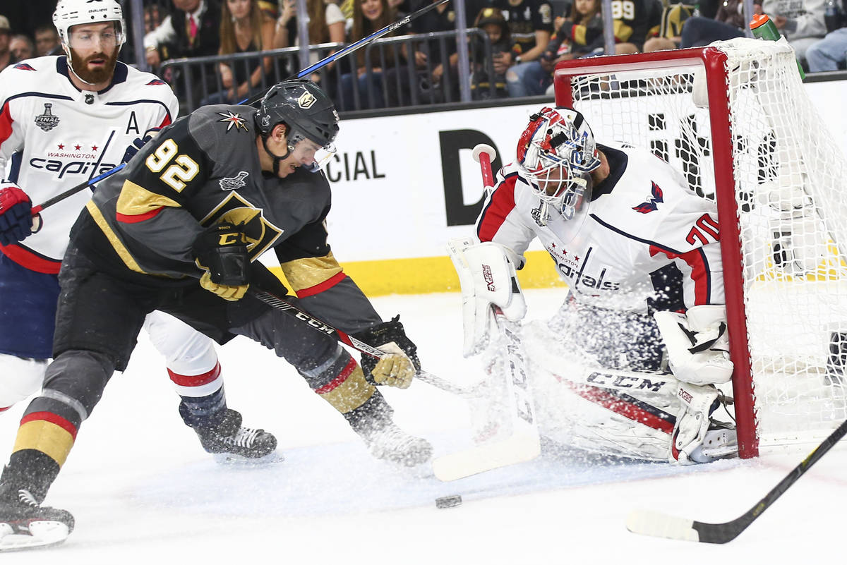 Golden Knights left wing Tomas Nosek (92) tries to get the puck in against Washington Capitals ...