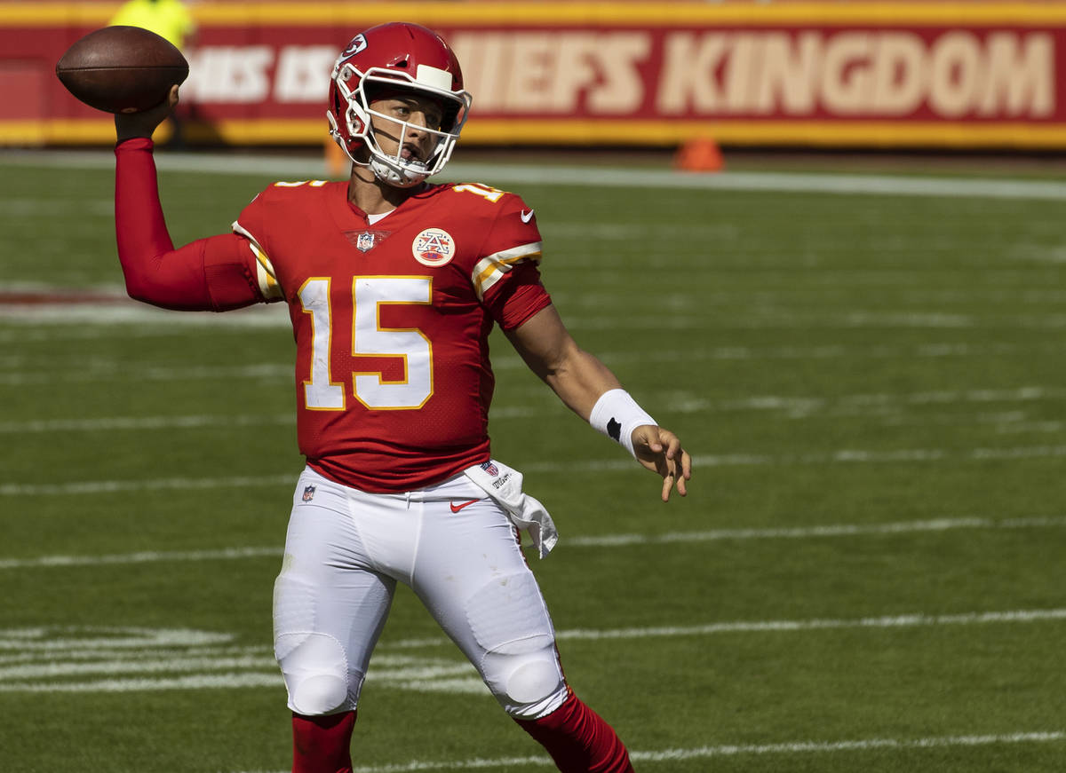 Kansas City Chiefs quarterback Patrick Mahomes (15) throws a touchdown pass in the second quart ...