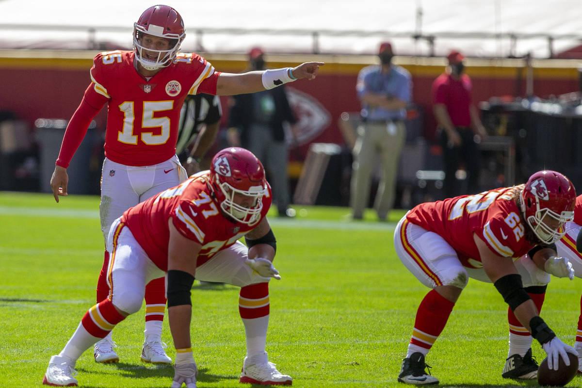 Kansas City Chiefs quarterback Patrick Mahomes (15) calls a play at the line of scrimmage as of ...
