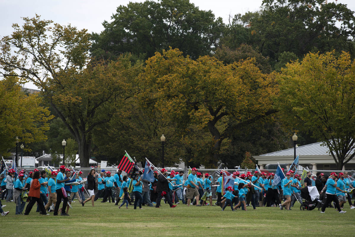 President Donald Trump supporters walk to the gate of the White House after a rally at The Elli ...