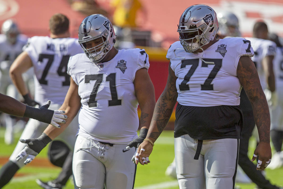 Las Vegas Raiders offensive tackle Denzelle Good (71) and Las Vegas Raiders offensive tackle Tr ...