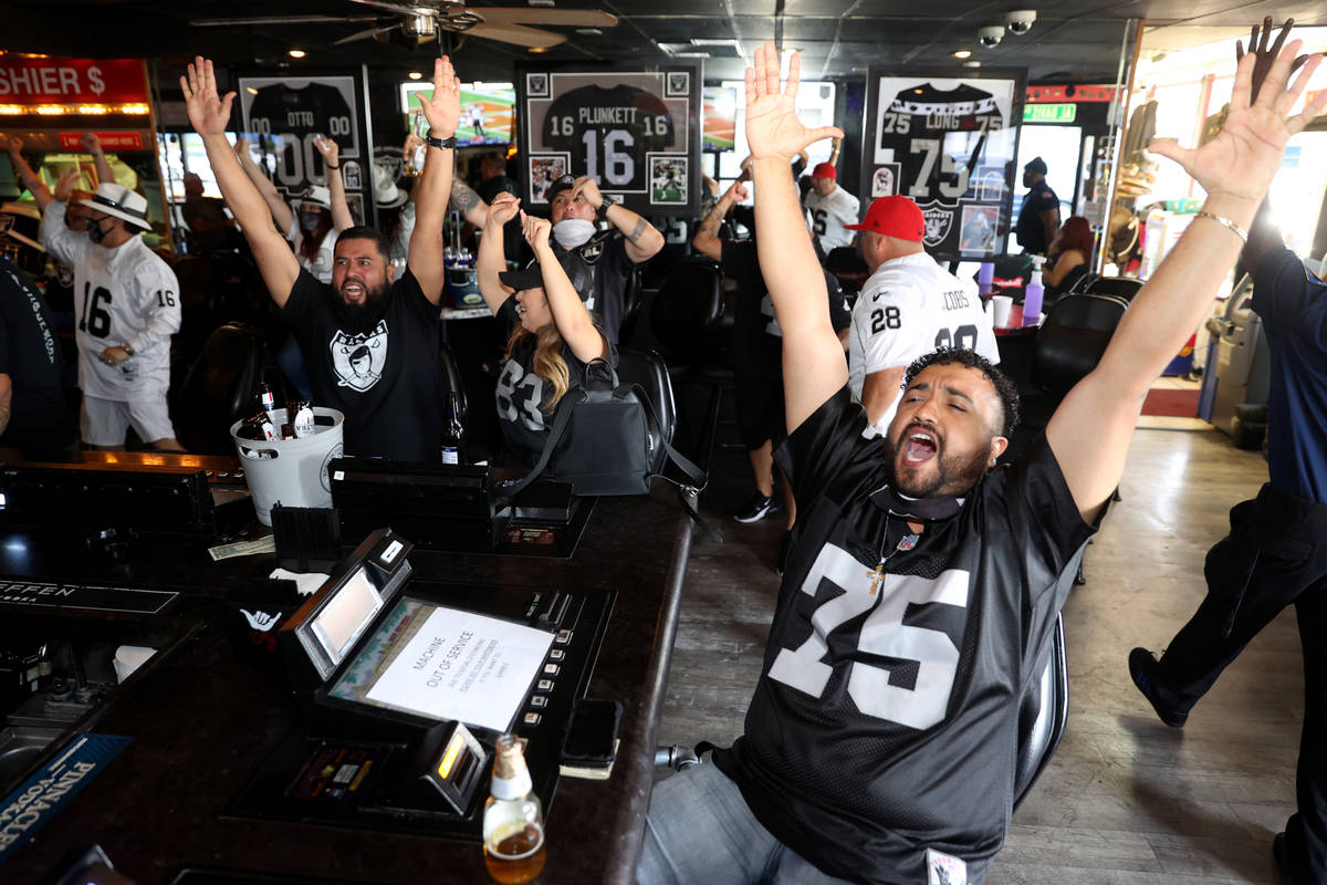 Las Vegas Raiders fans, including from right, Robert Lopez of Riverside, Calif., Cynthia and Hu ...