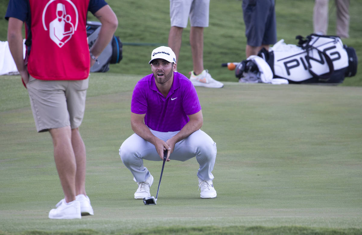 Matthew Wolff reacts after missing a putt on the 18th hole during a playoff in the final round ...