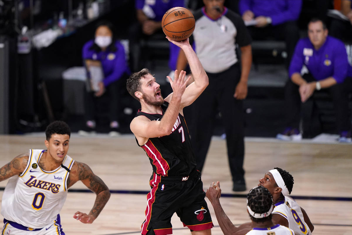 Miami Heat's Goran Dragic (7) shoots during the second half in Game 6 of basketball's NBA Final ...