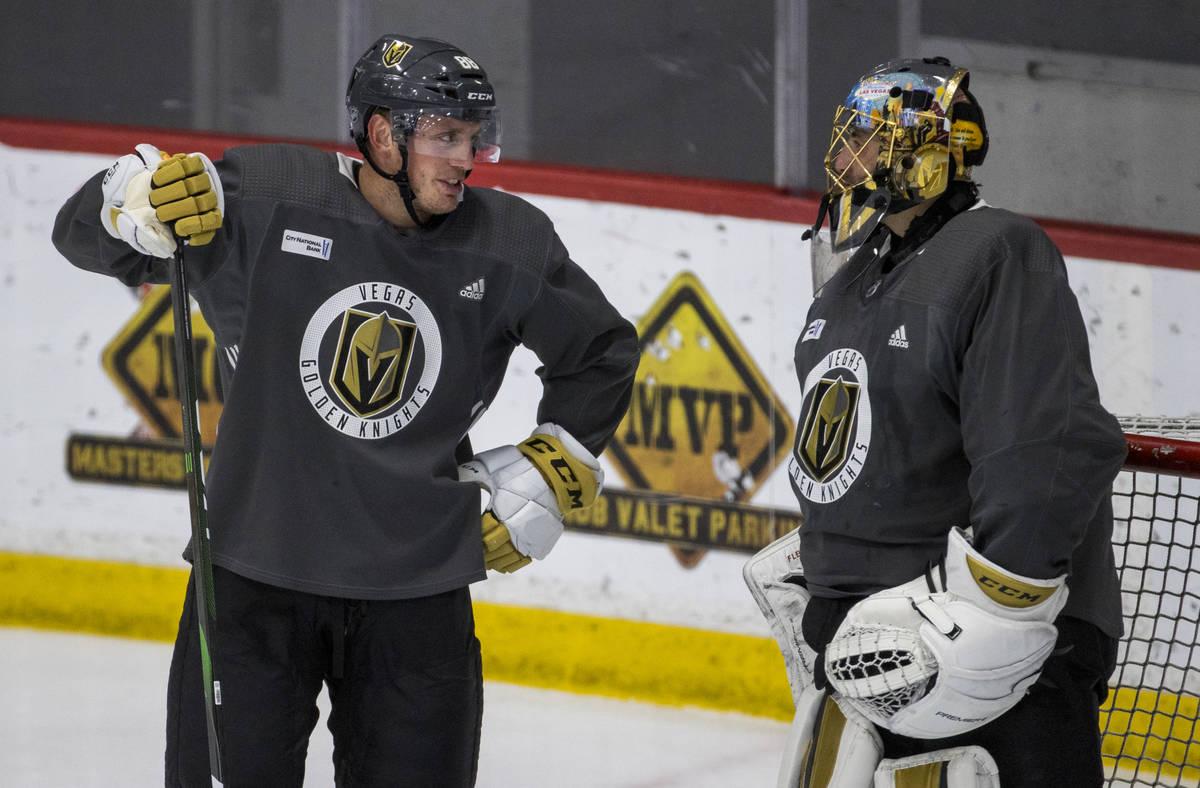 Vegas Golden Knights defenseman Nate Schmidt chats with goaltender Marc-Andre Fleury (29) durin ...