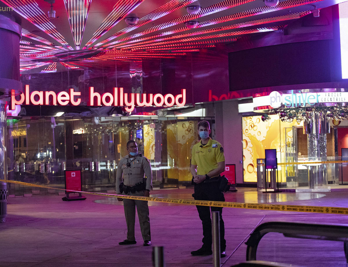 Police and security on the scene on the Strip where a man was shot at the Miracle Miles shops i ...