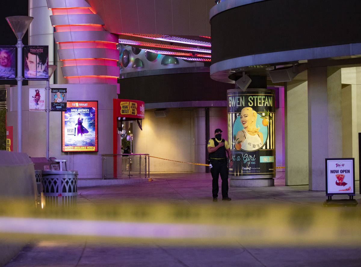 A security guard at the scene on the Strip where a man was shot at the Miracle Miles shops in L ...