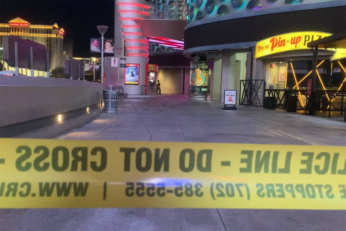 Police investigate a shooting outside the Miracle Mile Shops on the Las Vegas Strip on Sunday, ...