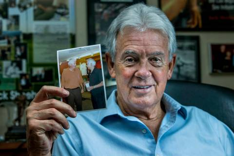Author Jack Sheehan in his home office with a photo of legendary former drug kingpin Jimmy Chag ...