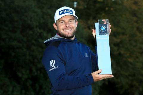 England's Tyrrell Hatton poses with the trophy after winning the PGA Championship at the Wentwo ...