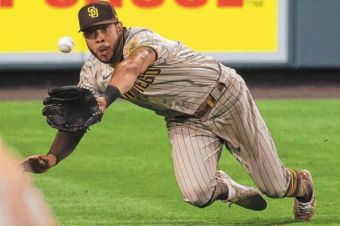 San Diego Padres left fielder Tommy Pham dives to catch a fly ball off the bat of Colorado Rock ...