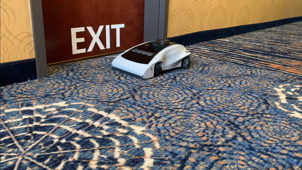 A later version of Maidbot's cleaning robot Rosie cleaning a suite at the Marina Bay Sands in S ...