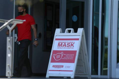 A signs reminds people to wear a mask at UNLV in Las Vegas, Friday, Sept. 4, 2020. (Erik Verduz ...