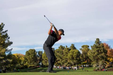 In this Nov. 23, 2018, file photo, Tiger Woods hits from the 9th fairway during The Match at Sh ...