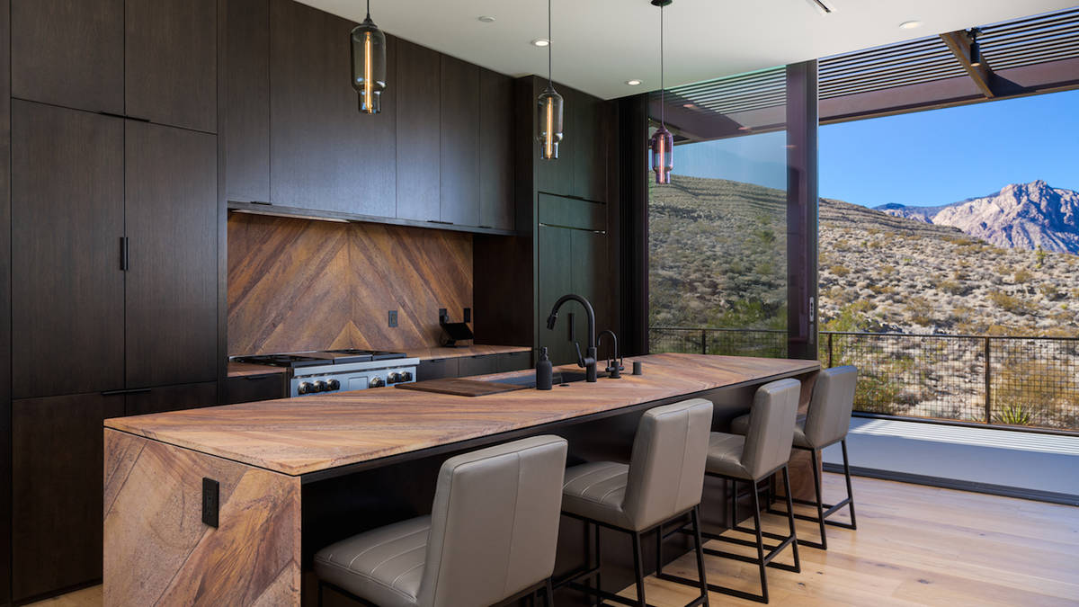 The upstairs kitchen has upgraded Wolf and Sub-Zero appliances and an island with seating. (The ...