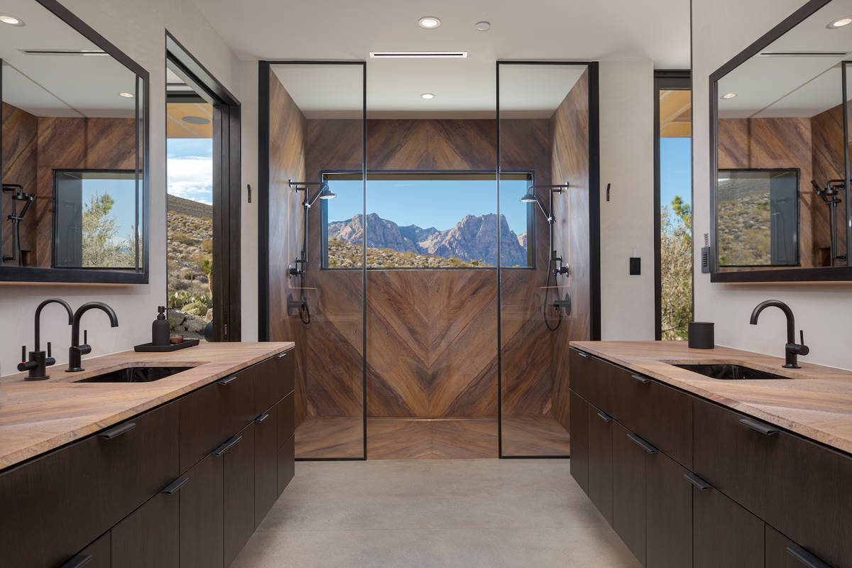 The master bath is in the lower-level master suite. It has high-end, spa-quality finishes. (The ...