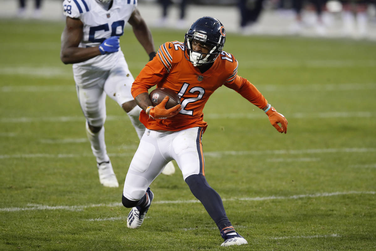 Chicago Bears wide receiver Allen Robinson (12) runs with the ball after a catch against the In ...