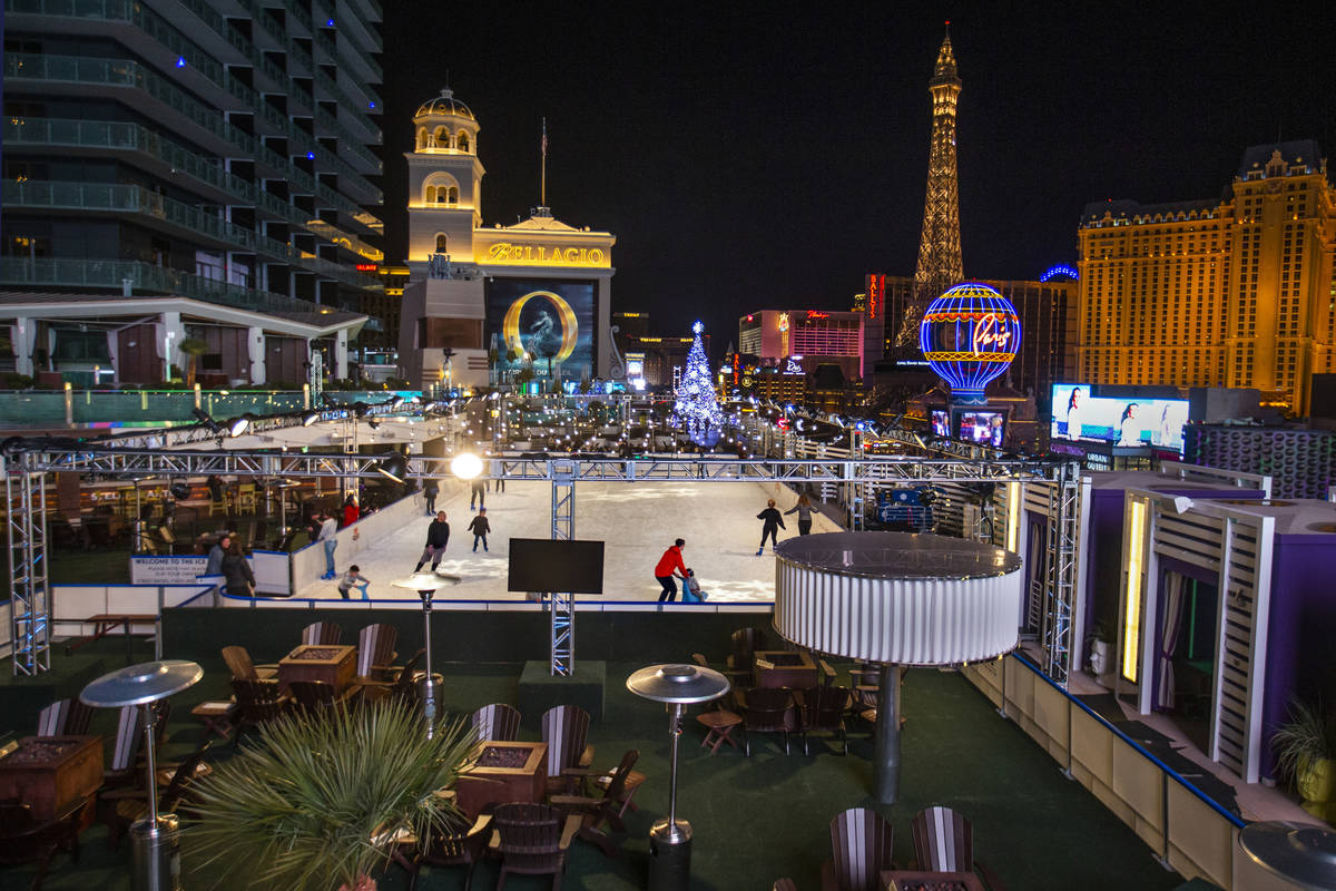 People enjoy some skating on the ice rink at The Cosmopolitan of Las Vegas on Monday, Dec. 2, 2 ...