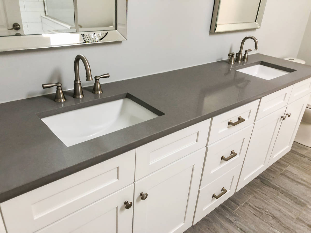 Double sinks and shaker cabinets are popular trends in bathroom remodels. (Getty Images)