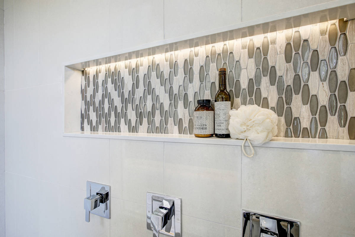 A long shower niche fitted with mosaic gray tiles is functional and beautiful. (Getty Images)